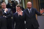 European Council President Charles Michel, right, gestures as he arrives for a round table meeting at an EU summit in Brussels, Thursday, Dec. 12, 2019. European Union leaders gather for their year-end summit and will discuss climate change funding, the departure of the UK from the bloc and their next 7-year budget. (AP Photo/Francisco Seco)