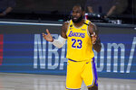 Los Angeles Lakers' LeBron James (23) reacts after a play against the Toronto Raptors during the first half of an NBA basketball game Saturday, Aug. 1, 2020, in Lake Buena Vista, Fla. (AP Photo/Ashley Landis, Pool)
