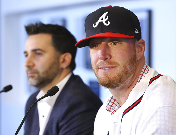 Atlanta Braves Executive Vice President and General Manager Alex Anthopoulos (left) and left-handed pitcher Will Smith, who just signed a three-year $39 million contract with a one year club option, take questions during a press conference introducing Smith at SunTrust Park on Tuesday, November 19, 2019, in Atlanta. (Curtis Compton/Atlanta Journal-Constitution via AP)