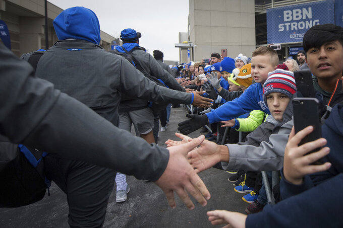 Fans greet Kentucky players as they arrive at Kroger Field before an NCAA college football game against Middle Tennessee in Lexington, Ky., Saturday, Nov. 17, 2018. (AP Photo/Bryan Woolston)