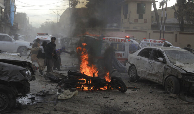 Pakistani rescue workers and volunteers help to remove victims at the site of a suicide bombing in Quetta, Pakistan, Monday, Feb. 17, 2020. The powerful bomb killed a few people and wounded dozen others in Pakistan's restive Baluchistan province local police said, when it struck an Islamist rally in the regional capital. (AP Photo/Arshad Butt)