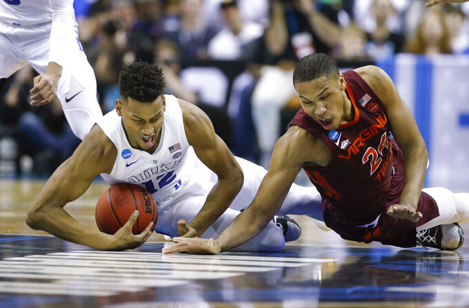 Duke forward Javin DeLaurier (12) beats out Virginia Tech forward Kerry Blackshear Jr. (24) to recover the ball during the first half of an NCAA men's college basketball tournament East Region semifinal Friday, March 29, 2019, in Washington. (AP Photo/Patrick Semansky)