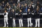 New York Yankees players listen to