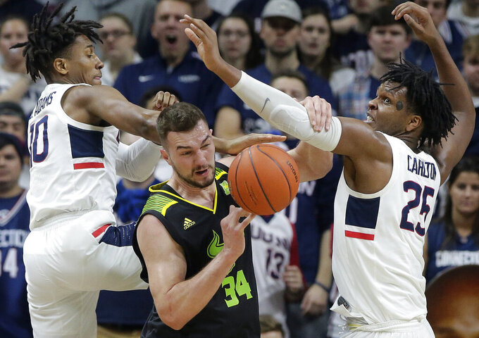 South Florida's Antun Maricevic (34), of Croatia, vies for a rebound with Connecticut's Brendan Adams (10) and Josh Carlton (25) during the second half of an NCAA college basketball game, Sunday, March 3, 2019, in Storrs, Conn. (AP Photo/Steven Senne)