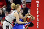 North Carolina State's Elissa Cunane, left, grabs the ball with Kentucky's Tatyana Wyatt during the first half of a second round women's college basketball game in the NCAA Tournament in Raleigh, N.C., Monday, March 25, 2019. (AP Photo/Gerry Broome)