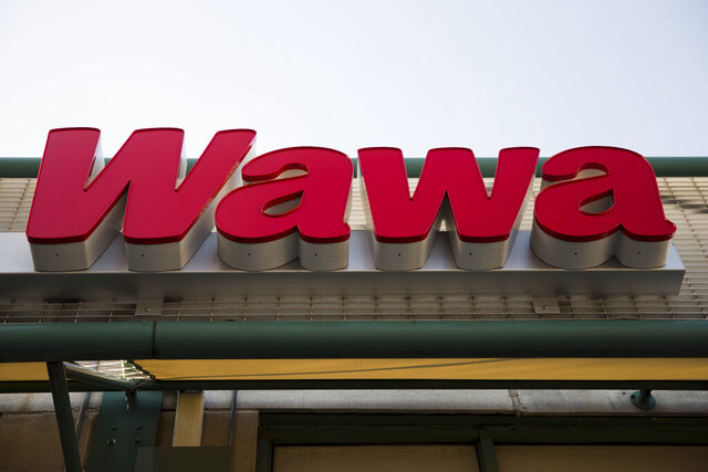 FILE - This April 2, 2015 file photo shows a Wawa convenience store in Philadelphia.  The convenience store chain is facing a wave of lawsuits over a data breach that affected its 850 locations along the East Coast. Wawa Inc. discovered malware on its payment processing servers this month before stopping the breach Dec. 12, 2019 the company has said. Officials with the company, based in Wawa, Pennsylvania, believe the malware had been collecting card numbers, customer names and other data since as early as March.(AP Photo/Matt Rourke, File)