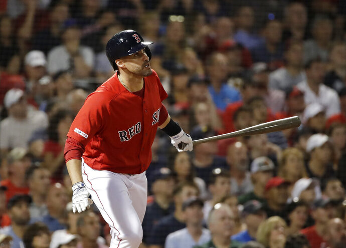 Boston Red Sox's J.D. Martinez watches his two-run home run during the fourth inning of the team's baseball game against the Los Angeles Angels at Fenway Park, Friday, Aug. 9, 2019, in Boston. (AP Photo/Elise Amendola)