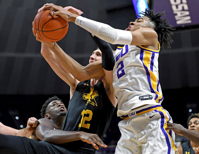 LSU forward Trendon Watford (2) battles for a rebound with Maryland-Baltimore COunty guard Brandon Horvath (12) as LSU forward Darius Days, left, watches during the first half of an NCAA college basketball game Tuesday, Nov. 19, 2019, in Baton Rouge, La. (AP Photo/Bill Feig)