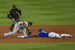 New York Yankees shortstop Gleyber Torres, center, loses the ball as Toronto Blue Jays' Cavan Biggio, right, reaches second on a fielding error by first baseman Luke Voit after a pickoff attempt during the fourth inning of a baseball game in Buffalo, N.Y., Wednesday, Sept. 23, 2020. (AP Photo/Adrian Kraus)