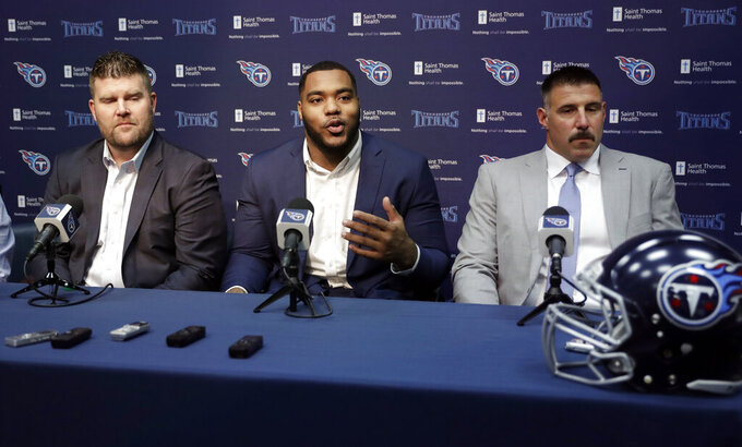 Mississippi State defensive tackle Jeffery Simmons, center, speaks at a news conference with Tennessee Titans general manager Jon Robinson, left, and head coach Mike Vrabel, right, Friday, April 26, 2019, in Nashville, Tenn. Simmons was selected in the first round of the NFL football draft by the Titans. (AP Photo/Mark Humphrey)