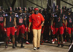 Austin Peay interim coach Marquase Lovings leads his team onto the field for an NCAA college football game against Central Arkansas on Saturday, Aug. 29, 2020, in Montgomery, Ala. (Jake Crandall/The Montgomery Advertiser via AP)