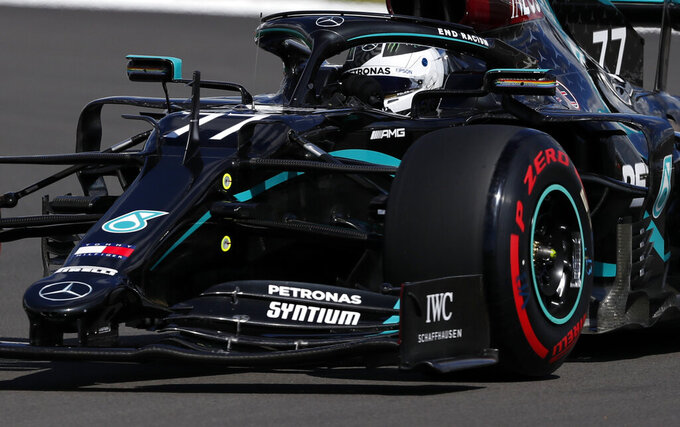 Mercedes driver Valtteri Bottas of Finland steers his car during the qualifying session for the British Formula One Grand Prix at the Silverstone racetrack, Silverstone, England, Saturday, Aug. 1, 2020. The British Formula One Grand Prix will be held on Sunday. (AP Photo/Frank Augstein,Pool)