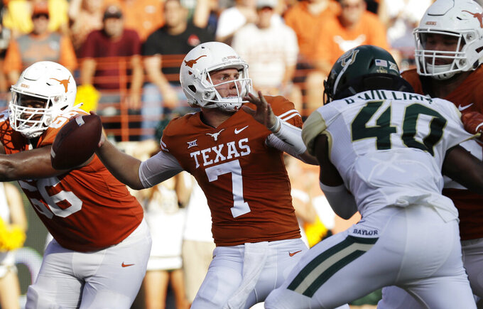 FILE - In this Saturday, Oct. 13, 2018, file photo, Texas quarterback Shane Buechele (7) throws against Baylor during the second half of an NCAA college football game, in Austin, Texas. Experienced backup Buechele entered the NCAA transfer database Thursday, Jan. 17, 2019, and could be playing somewhere else next season. (AP Photo/Eric Gay, File)