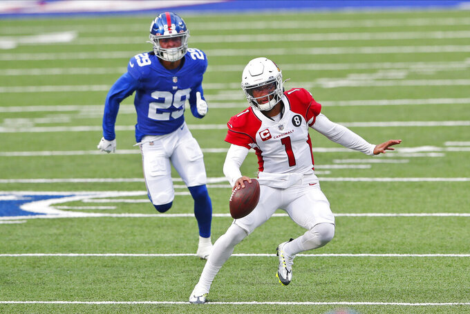 Arizona Cardinals quarterback Kyler Murray, right, runs the ball during the first half of an NFL football game against the New York Giants, Sunday, Dec. 13, 2020, in East Rutherford, N.J. (AP Photo/Noah K. Murray)