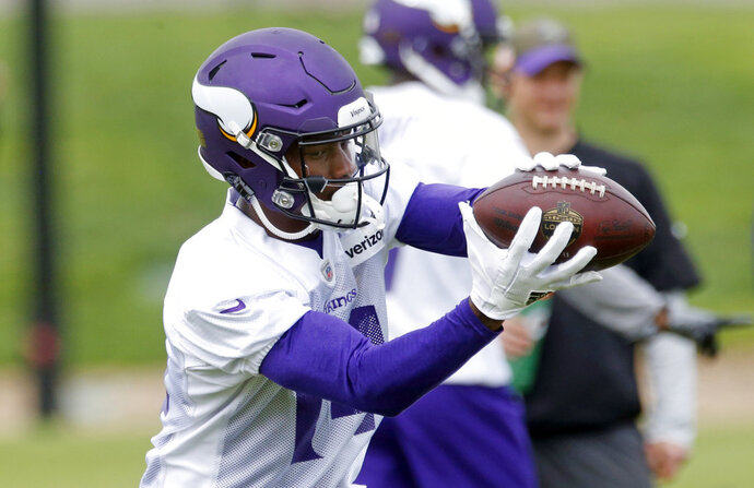 Minnesota Vikings wide receiver Stefon Diggs takes a break during practice at the NFL football team's training camp Wednesday, May 23, 2018, in Eagan, Minn. Diggs has entered the final year of his rookie contract with the Minnesota Vikings, bound for a big raise. He's also working with his fourth primary starting quarterback in as many NFL seasons and his third offensive coordinator. (AP Photo/Jim Mone)