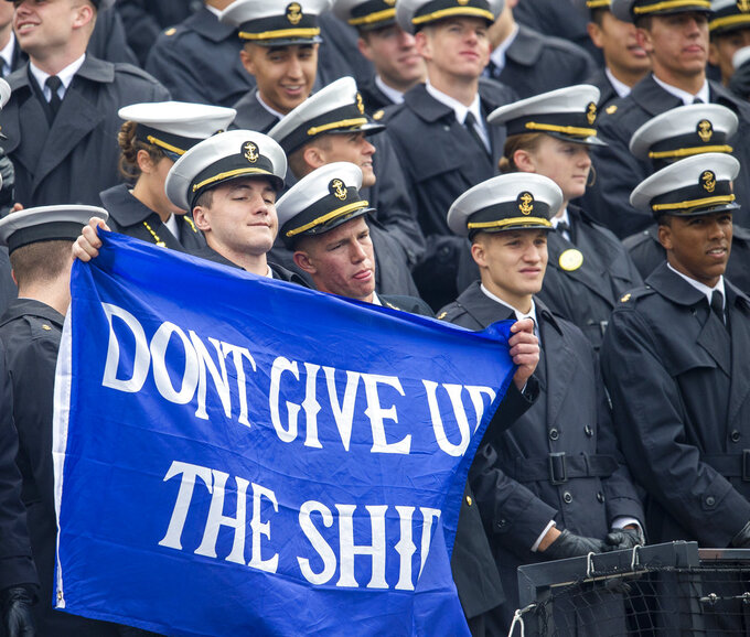 Navy Midshipmen hold a sign against Air Force during an NCAA college football game at Falcon Stadium at the U.S. Air Force Academy, Saturday Oct. 6, 2018, in Colorado Springs, Colo.  (Dougal Brownlie,/The Gazette via AP)