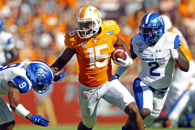 Tennessee wide receiver Jauan Jennings (15) runs for yardage as he is chased by Georgia State safety Cedric Stone (9) and linebacker Ed Curney (2) in the first half of an NCAA college football game Saturday, Aug. 31, 2019, in Knoxville, Tenn. (AP Photo/Wade Payne)
