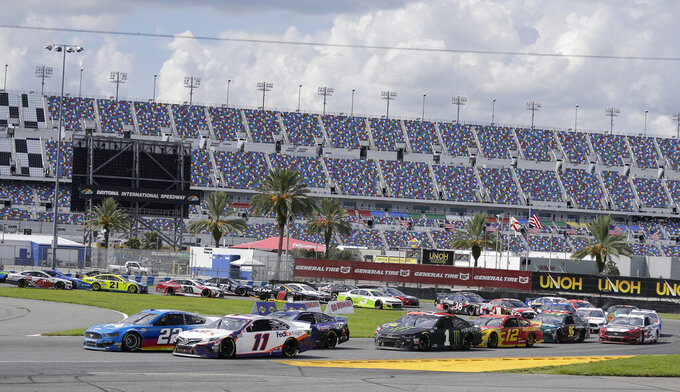 Denny Hamlin (11) and Joey Logano (22) race for the lead during a NASCAR Cup Series auto race at Daytona International Speedway, Sunday, Aug. 16, 2020, in Daytona Beach, Fla. (AP Photo/Terry Renna)