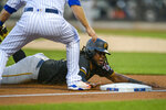 Pittsburgh Pirates Josh Bell slides into third base underneath New York Mets third baseman Todd Frazier on a hit by Pittsburgh Pirates Bryan Reynolds during the second inning of a baseball game, Friday, July 26, 2019, in New York. (AP Photo/Corey Sipkin)