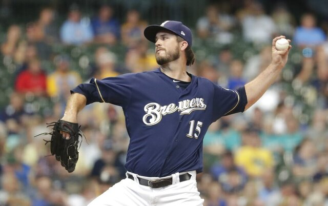 FILE - In this Sept. 19, 2019, file photo, Milwaukee Brewers' Drew Pomeranz throws during the seventh inning of the team's baseball game against the San Diego Padres in Milwaukee. The rebuilding San Diego Padres rewarded free agent Pomeranz for two strong months in Milwaukee's bullpen. San Diego and Pomeranz — an All-Star during his brief stay with San Diego in 2016 — agreed to a $34 million, four-year contract. The left-hander had a strong final two months of the season with the Brewers after being traded to Milwaukee from San Francisco. He was 0-1 with a 2.39 ERA in 25 games, including one start. (AP Photo/Morry Gash, File)