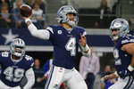 Dallas Cowboys quarterback Dak Prescott (4) throws in the first quarter of an NFL football game against the Los Angeles Rams in Arlington, Texas, Sunday, Dec. 15, 2019. (AP Photo/Michael Ainsworth)