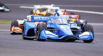 Alex Palou, of Spain, navigates through a turn on the course during a practice session for the IndyCar auto race at Indianapolis Motor Speedway, Friday, Aug. 13, 2021, in Indianapolis. (AP Photo/Doug McSchooler)