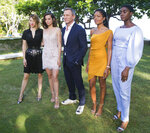 FILE - In this Thursday, April 25, 2019 file photo, actors from left,  Lea Seydoux, Ana de Armas, Daniel Craig, Naomie Harris and Lashana Lynch pose for photographers during the photo call of the latest installment of the James Bond film franchise, in Oracabessa, Jamaica. Producers of the forthcoming James Bond thriller say the film's release has been delayed again, until the fall of 2021, because of the effects of the coronavirus pandemic. The official 007 Twitter account said late Thursday, Jan. 21, 2021 that the 25th installment in the franchise will now open on Oct. 8. (AP Photo/Leo Hudson, FIle)