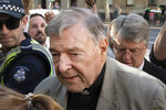 FILE - In this Feb. 27, 2019, file photo, Cardinal George Pell arrives at the County Court in Melbourne, Australia. Australia's highest court on Tuesday, April 7, 2020 has dismissed the convictions of the most senior Catholic found guilty of child sex abuse. (AP Photo/Andy Brownbill, File)