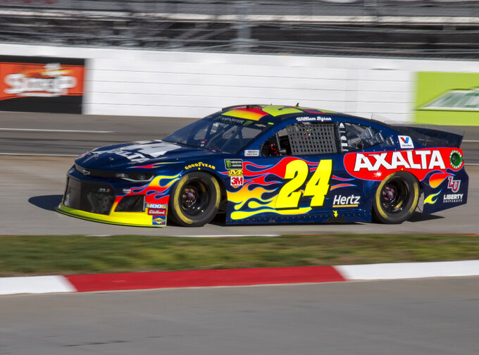 William Byron races for position during qualifying for the NASCAR Monster Energy Cup Series race at Martinsville Speedway in Martinsville, Va., Saturday, March 23, 2019. (AP Photo/Matt Bell)