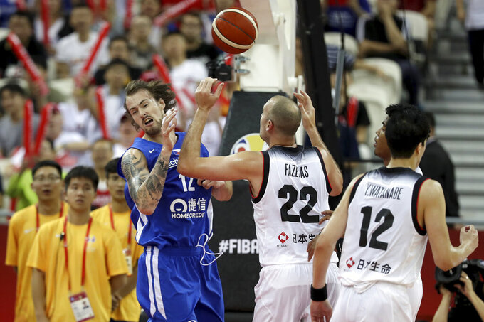 Czech Republic's Ondrej Balvin, left reacts near Japan's Nick Fazekas, center and Japan's Yuta Watanabe at right during a Group E match for the FIBA Basketball World Cup at the Shanghai Oriental Sports Center in Shanghai on Tuesday, Sept. 3, 2019. (AP Photo/Ng Han Guan)