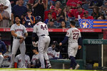 Houston Astros' Yordan Alvarez, center, celebrates with Jose Siri, left, and Jose Altuve after hitting a two-run home run during the first inning of a baseball game against the Los Angeles Angels Wednesday, Sept. 22, 2021, in Anaheim, Calif. (AP Photo/Mark J. Terrill)