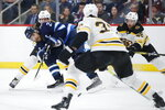 Winnipeg Jets' Blake Wheeler (26) tries to get the shot away Boston Bruins' Joakim Nordstrom (20) and Zdeno Chara (33) defend during the second period of an NHL hockey game Friday, Jan. 31, 2020, in Winnipeg, Manitoba. (John Woods/The Canadian Press via AP)