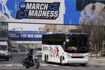The Florida basketball team is escorted to Hinkle Fieldhouse for the NCAA college basketball tournament, Wednesday, March 17, 2021, in Indianapolis. (AP Photo/Darron Cummings)