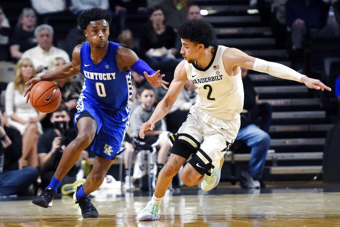 Kentucky guard Ashton Hagans (0) dribbles the ball past Vanderbilt guard Scotty Pippen Jr. (2) during the second half of an NCAA college basketball game Tuesday, Feb. 11, 2020, in Nashville, Tenn. Kentucky won 78-64. (AP Photo/Mark Zaleski)