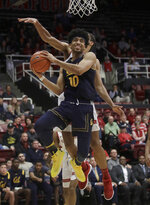 California forward Justice Sueing (10) goes to the basket in front of Stanford forward Oscar Da Silva during the second half of an NCAA college basketball game in Stanford, Calif., Thursday, March 7, 2019. (AP Photo/Jeff Chiu)