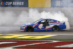 Kyle Larson does a burnout after winning a NASCAR Cup Series auto race Sunday, March 7, 2021, in Las Vegas. (AP Photo/John Locher)