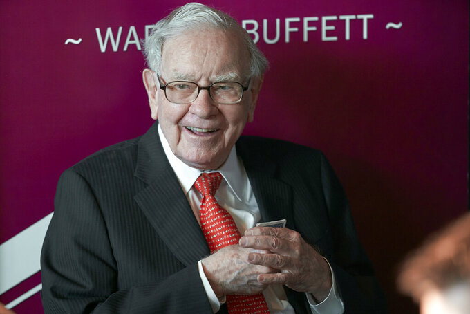 FILE - In this May 5, 2019, file photo Warren Buffett, Chairman and CEO of Berkshire Hathaway, smiles as he plays bridge following the annual Berkshire Hathaway shareholders meeting in Omaha, Neb. Billionaire Buffett's company has again increased the size of its bet on grocery giant Kroger, while scaling back several of its health care industry investments. Berkshire Hathaway Inc. said in a quarterly update with regulators Monday, Aug. 16, 2021, that it picked up nearly 11 million shares of Kroger stock during the second quarter, raising its holdings to 61.8 million shares. Buffett's company has been steadily adding to its Kroger holdings in recent quarters. (AP Photo/Nati Harnik, File)