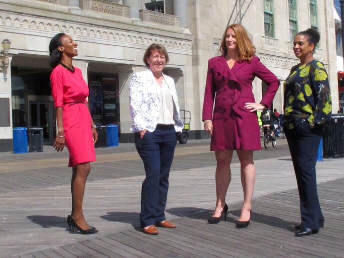 The four women who run Atlantic City casinos pose for photos on the Atlantic City N.J. Boardwalk on Sept. 21, 2020: From left, to right they are: Jacqueline Grace of Tropicana; Terry Glebocki of Ocean Casino Resort; Karie Hall of Bally's, and Melonie Johnson of Borgata. Four of Atlantic City's nine casinos are run by women. (AP Photo/Wayne Parry)