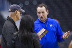 CBS director Bob Fishman, left, talks with Duke head coach Mike Krzyzewski, and CBS' Tracy Wolfson during an NCAA men's college basketball practice in Washington, Thursday, March 28, 2019. Fishman is in his 28th year as lead director of CBS Sports NCAA Men's Basketball Championship and Final Four coverage. (AP Photo/Alex Brandon)