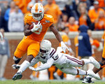 Tennessee running back Ty Chandler (8) runs for yardage as he's hit by Mississippi State cornerback Cameron Dantzler (3) in the second half of an NCAA college football game Saturday, Oct. 12, 2019, in Knoxville, Tenn. (AP Photo/Wade Payne)