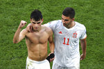Spain's Ferran Torres, right, and Pedri celebrate a victory of their team after the end of the Euro 2020 soccer championship round of 16 match between Croatia and Spain, at Parken stadium in Copenhagen, Denmark, Monday, June 28, 2021. (Wolfgang Rattay, Pool via AP)