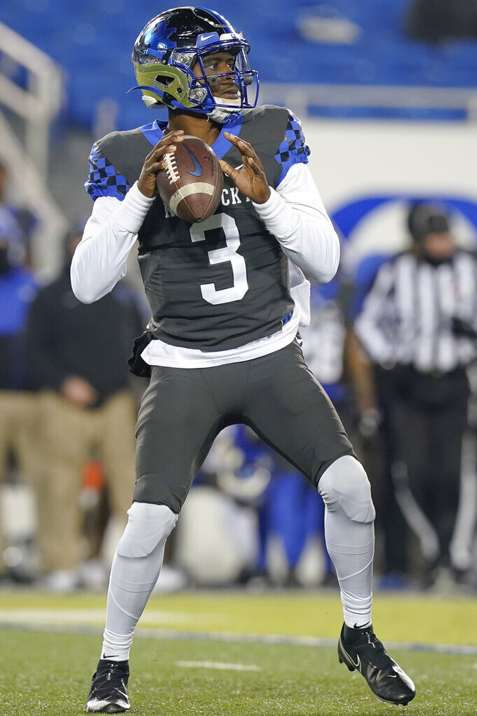 Kentucky quarterback Terry Wilson looks to throw a pass during the first half of an NCAA college football game against South Carolina, Saturday, Dec. 5, 2020, in Lexington, Ky. (AP Photo/Bryan Woolston)