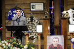 Jake Heinzmann, a longtime friend of Tyler Trent, speaks during a funeral for Trent at College Park Church, Tuesday, Jan. 8, 2019, in Indianapolis. Trent, an avid Purdue fan, died on New Year's Day, following a bout with bone cancer. (AP Photo/Darron Cummings, Pool)
