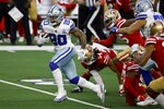 Dallas Cowboys running back Tony Pollard (20) breaks through San Francisco 49ers tackle attempts on his way to the end zone for a touchdown in the second half of an NFL football game in Arlington, Texas, Sunday, Dec. 20, 2020. (AP Photo/Ron Jenkins)