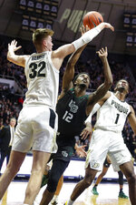 Purdue center Matt Haarms (32) blocks the shot of Green Bay forward Josh McNair (12) during the first half of an NCAA college basketball game in West Lafayette, Ind., Wednesday, Nov. 6, 2019. (AP Photo/Michael Conroy)