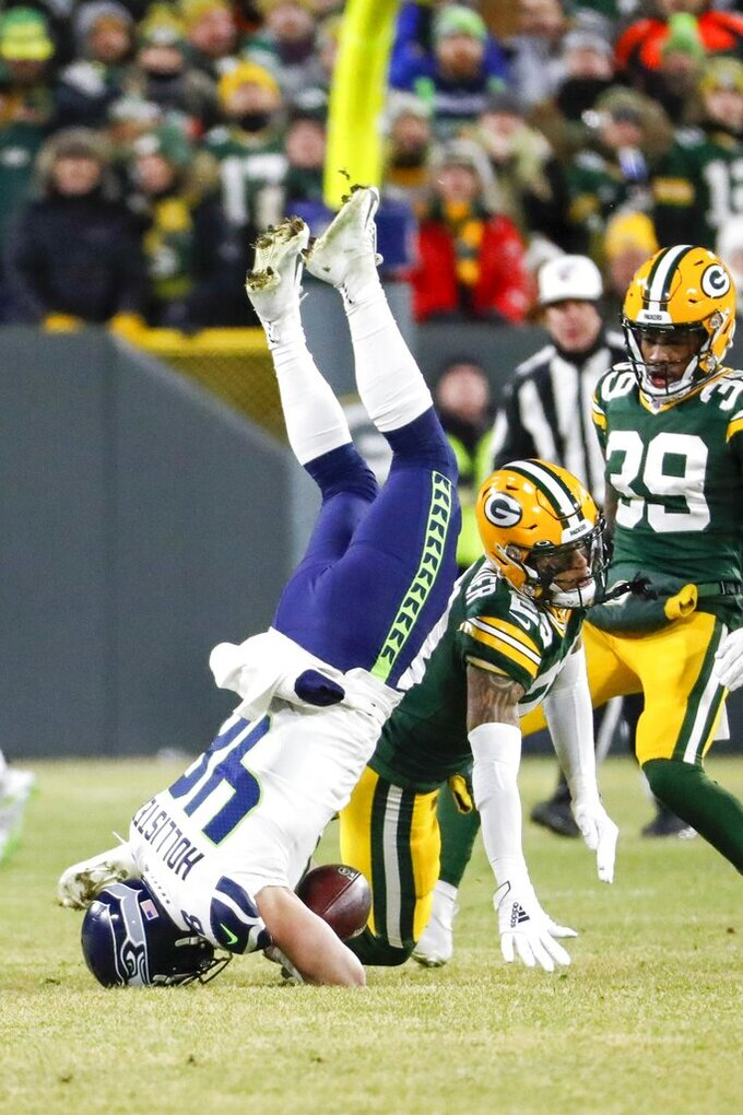 Seattle Seahawks' Jacob Hollister fumbles as he is hit by Green Bay Packers' Jaire Alexander during the first half of an NFL divisional playoff football game Sunday, Jan. 12, 2020, in Green Bay, Wis. (AP Photo/Matt Ludtke)