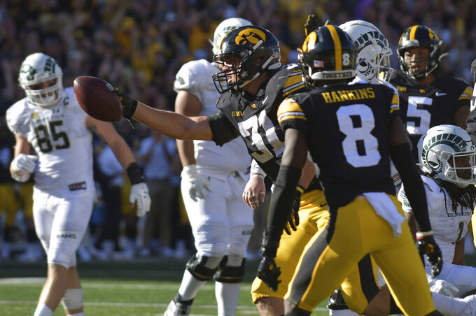 Iowa linebacker Jack Campbell (31) recovers a fumble during the second half of an NCAA college football game against Colorado State, Saturday, Sept. 25, 2021, in Iowa City, Iowa. (AP Photo/Ron Johnson)