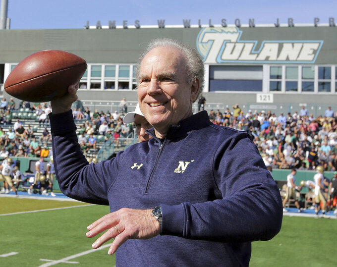 Former Navy quarterback and Pro Football Hall of Famer Roger Staubach throws a football before an NCAA college football game between Navy and Tulane at Yulman Stadium in New Orleans, Saturday, Nov. 24, 2018. (David Grunfeld/The Times-Picayune via AP)