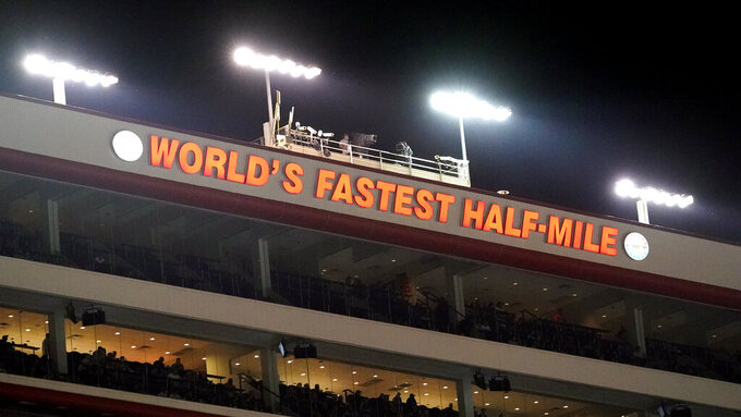Fans watch from suites during a NASCAR Cup Series auto race at Bristol Motor Speedway Saturday, Sept. 18, 2021, in Bristol, Tenn. (AP Photo/Mark Humphrey)
