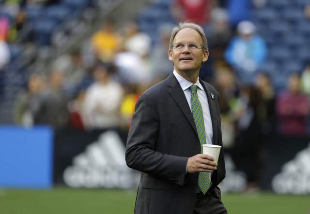 FILE - In this July 17, 2019, file photo, Seattle Sounders head coach Brian Schmetzer walks on the pitch before an international friendly soccer match against Borussia Dortmund in Seattle. The MLS soccer team announced Monday, Jan. 25, 2021, that the team and Schmetzer had reached agreement on a multiyear contract extension. (AP Photo/Ted S. Warren, File)